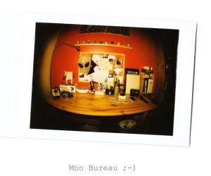 Vue du bureau avec les appareils photos de Stéphane (FishEye  Instax Mini Fuji )